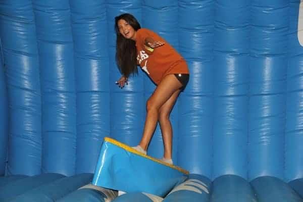 Texas girl on surfboard simulator - Party rental