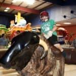Child riding mechanical bull