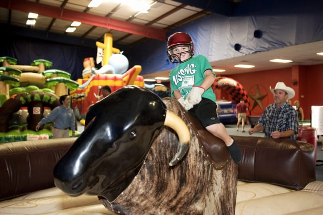 Child riding mechanical bull